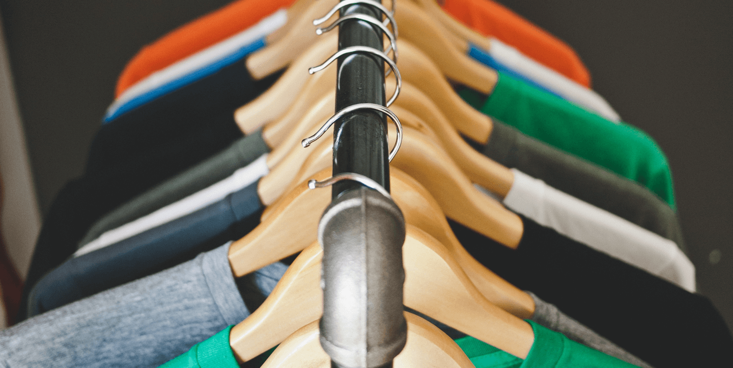 T-shirts hanging on a metal clothes rack