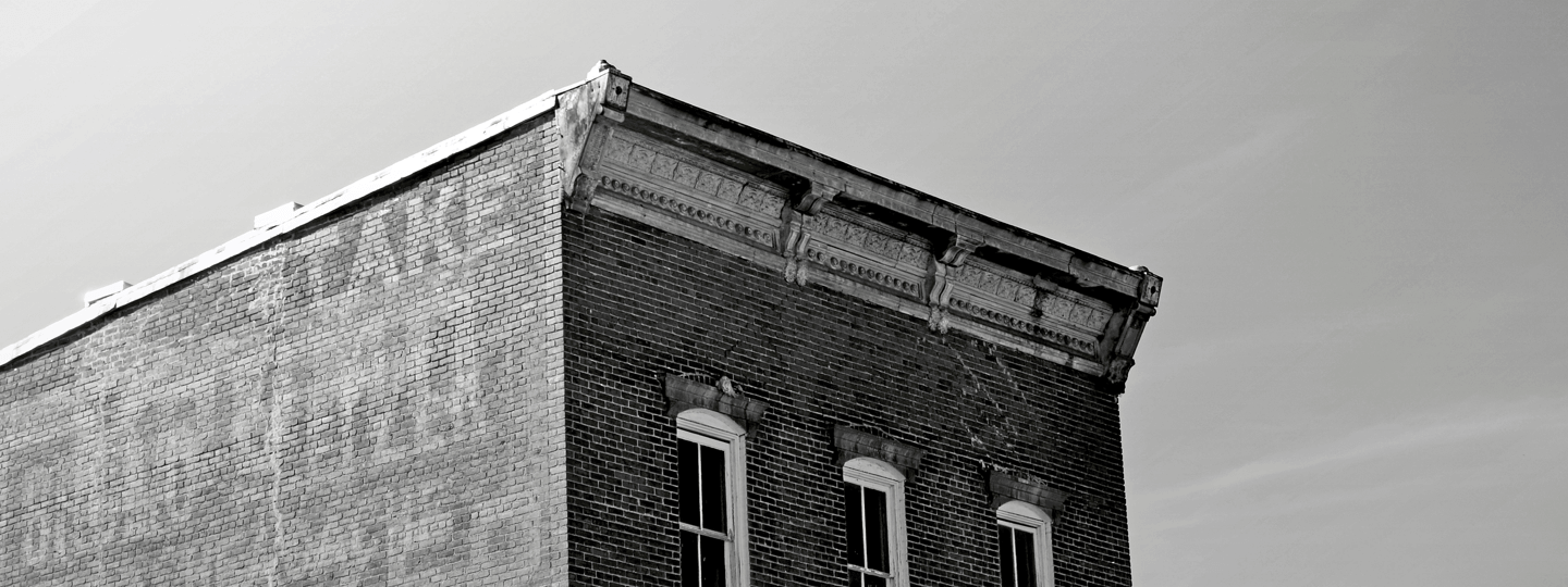 An old brick building with three windows