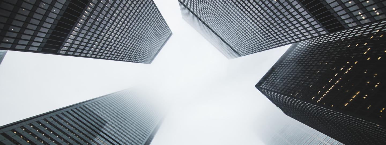 Looking up between 4 large high rise buildings
