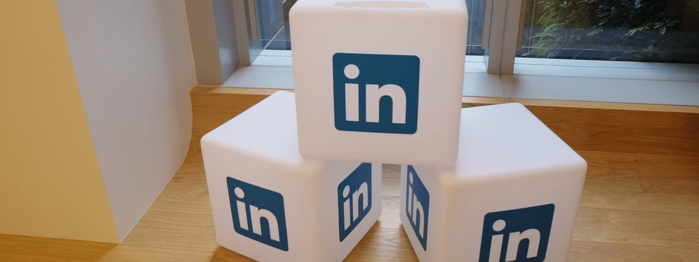 White cubes with the Linkedin logo on each side
