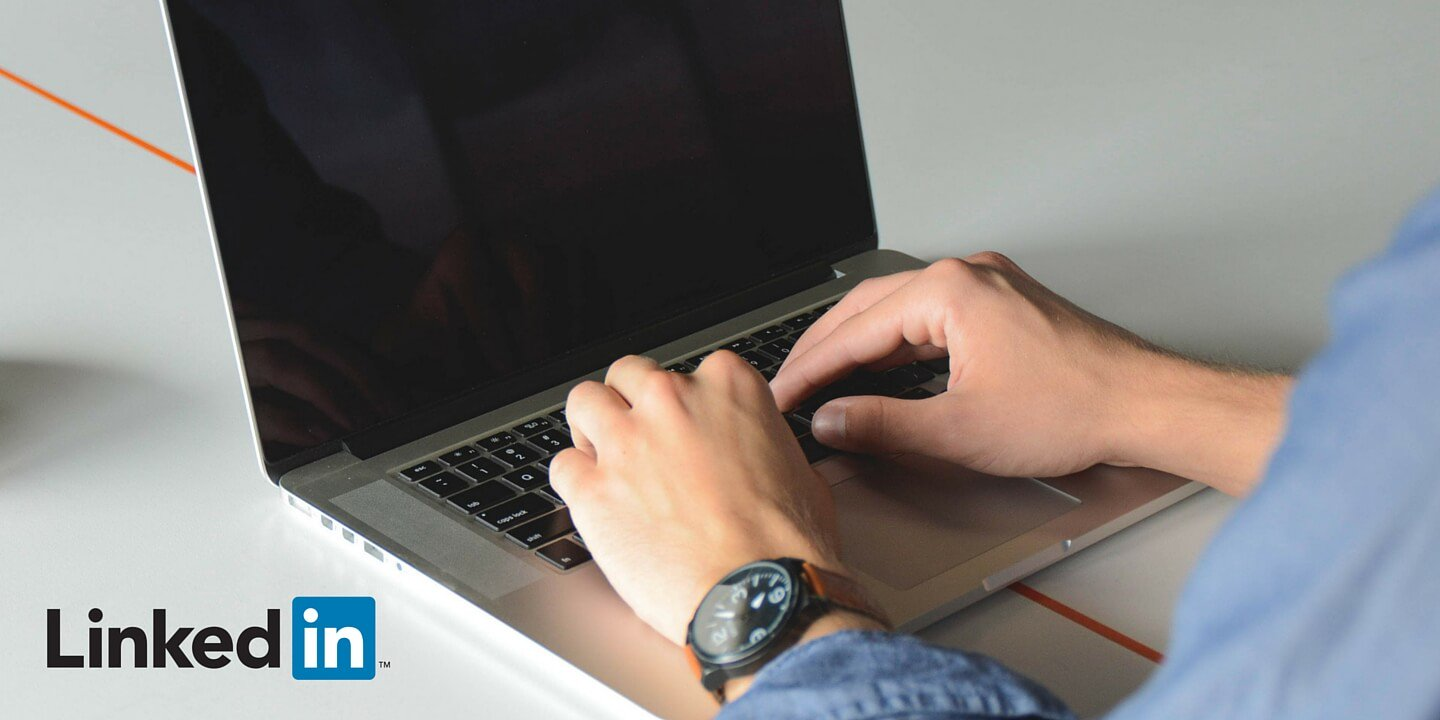 A person working on a laptop overlayed with the Linkedin logo