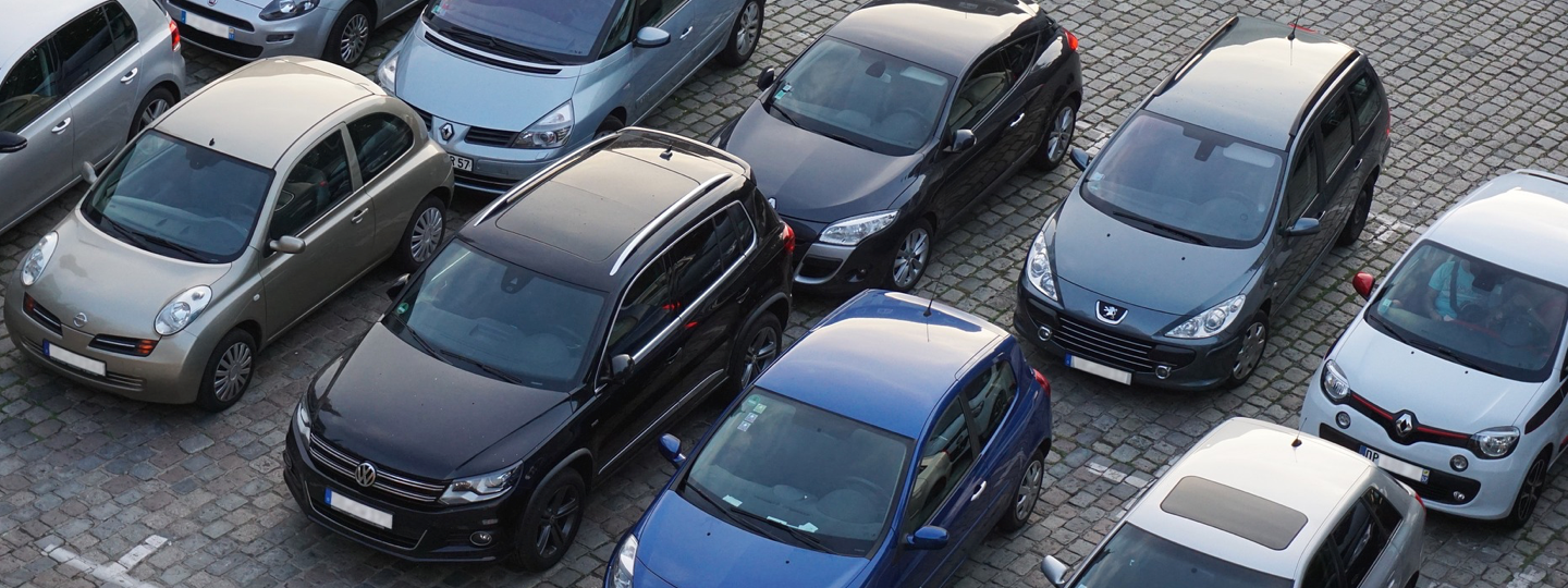 Several cars parked in a parking lot