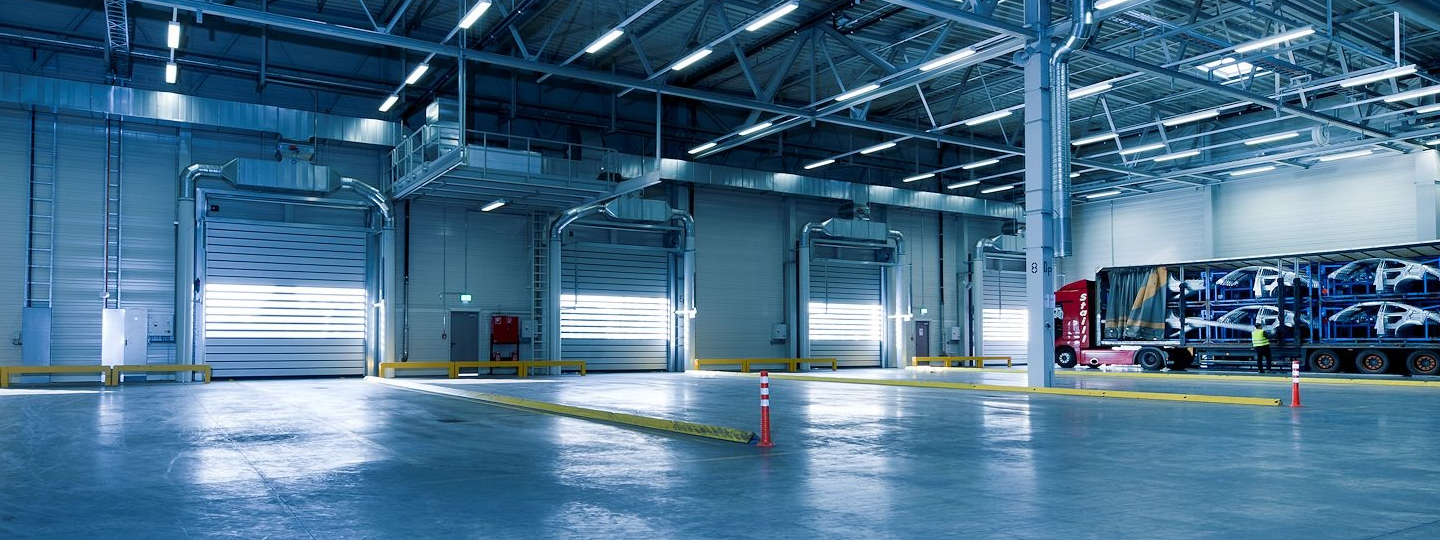 Inside a large warehouse looking towards 4 loading bays