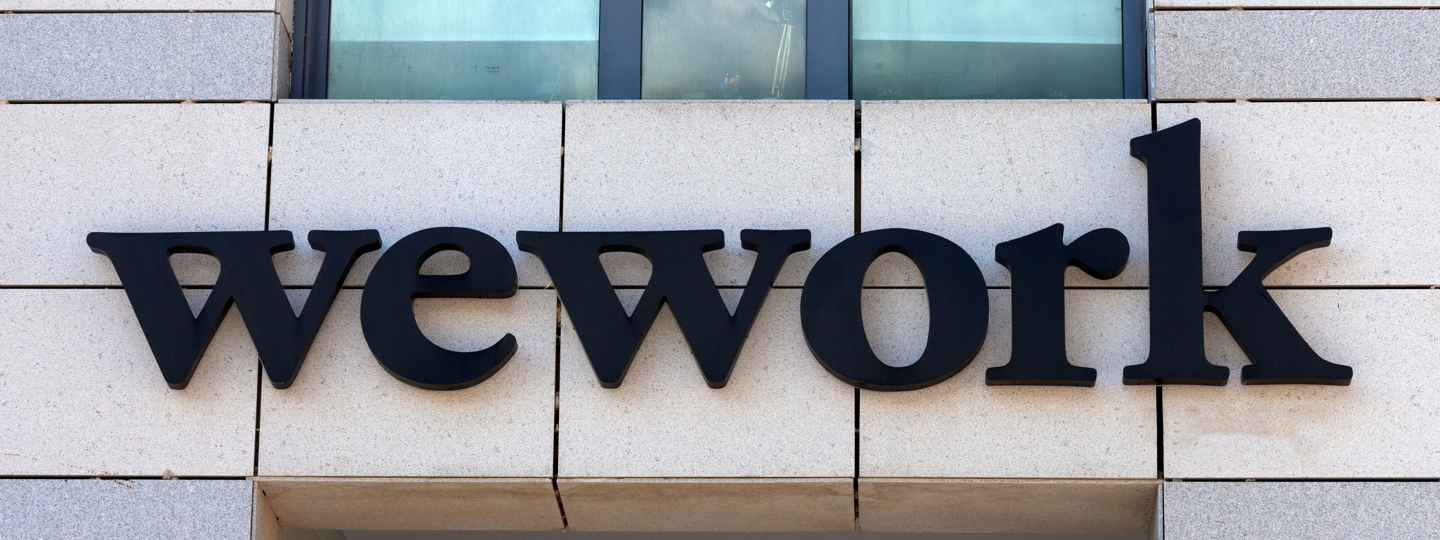 The Wework logo on the side of a building