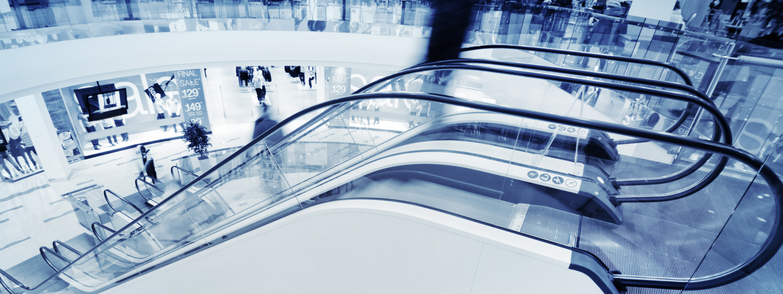 A row of escalators at a large mall