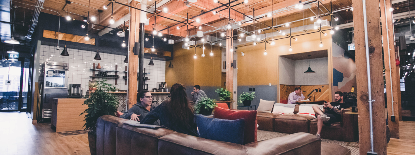 People inside a hip coffee shop with couches